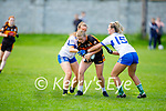 Austin Stacks Eimear O'Sullivan been tackled by Paris McCarthy and Labhaoise Walmsley of Castleisland Desmonds in the Kerry Ladies Intermediate Football championship game