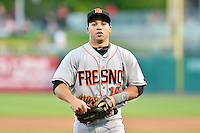 Juan Perez (18) of the Fresno Grizzlies during the game against the Salt Lake Bees at Smith's Ballpark on May 25, 2014 in Salt Lake City, Utah.  (Stephen Smith/Four Seam Images)