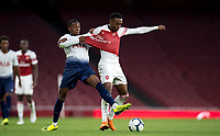 Jaden Brown of Tottenham Hotspur pulls at Joseph Willock of Arsenal shirt during the Premier League 2 match between Arsenal U23 and Tottenham Hotspur U23 at the Emirates Stadium, London, England on 31 August 2018. Photo by Andy Rowland.