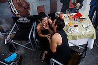 Meme tries to kiss Ceci during a break from tango dancing at a restaurant in the El Caminito area of Buenos Aires where they work. They dance together most of the time as it is better to have partners who know each other's movements and can choreograph together.