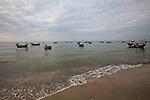 Fishing boats float in the flat sea off Mui Ne, Vietnam. Nov. 20, 2011.