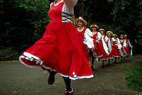 Women / Ladies Tiddley Cove Morris Dancers dancing at Burnaby Village Museum Festival, Burnaby, BC, British Columbia, Canada