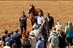 """DEL MAR, CA  JULY 28:  Eduardo G. """"Lalo"""" Luna, Humberto Gomez and Jimmy Barnes escort Triple Crown winner Justify on the track to celebrate his achievements on July 28, 2018 at Del Mar Thoroughbred Club in Del Mar, CA.  (Photo by Casey Phillips/Eclipse Sportswire/Getty Images)"""