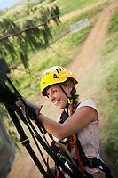 Woman preparing to rapell while ziplining