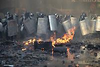 A deployment of Berkut riot police moves forward in Maidan Square. Kiev, Ukraine
