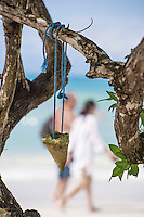 Couple walking along the beach, Negril, Jamaica