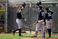 FCL Yankees Trey Sweeney (33) is congratulated by Antonio Gomez (55) and Jose Colmenares (12) after hitting his first professional home run during a game against the FCL Tigers West on July 31, 2021 at Tigertown in Lakeland, Florida.  (Mike Janes/Four Seam Images)