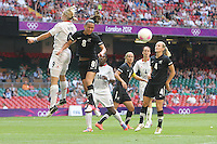 Hayley MOORWOOD of New Zealand heads clear from Ellen WHITE of Great Britain - Great Britain Women vs New Zealand Women - Womens Olympic Football Tournament London 2012 Group E at the Millenium Stadium, Cardiff, Wales - 25/07/12 - MANDATORY CREDIT: Gavin Ellis/SHEKICKS/TGSPHOTO - Self billing applies where appropriate - 0845 094 6026 - contact@tgsphoto.co.uk - NO UNPAID USE.