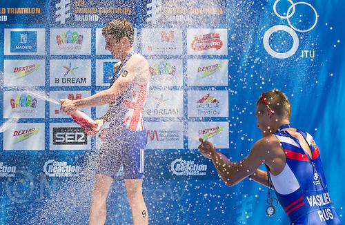 02 JUN 2013 - MADRID, ESP - Jonathan Brownlee (GBR) (left) of Great Britain celebrates winning the men's ITU 2013 World Triathlon Series round in Casa de Campo, Madrid, Spain, with silver medalist Javier Gomez (ESP) (not pictured) of Spain and bronze medalist Ivan Vasiliev (RUS) of Russia (right) (PHOTO (C) 2013 NIGEL FARROW)