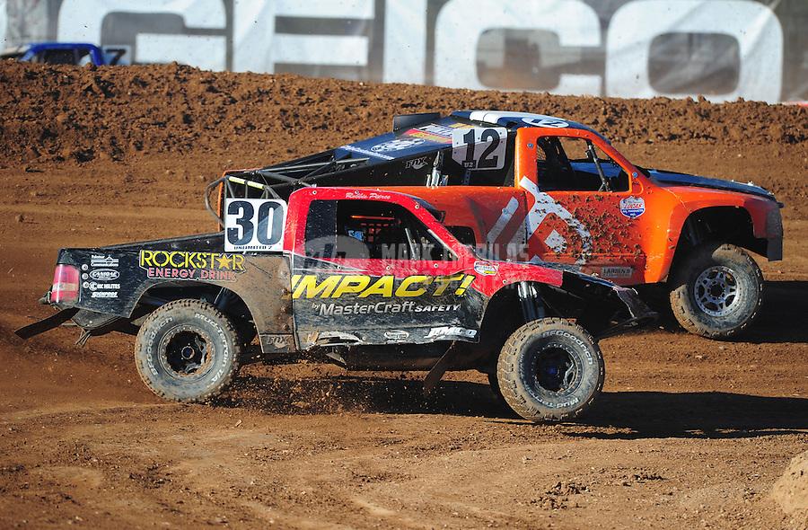 Apr 16, 2011; Surprise, AZ USA; LOORRS driver Robbie Pierce (30) and Myan Spaccarelli (12) during round 3 at Speedworld Off Road Park. Mandatory Credit: Mark J. Rebilas-