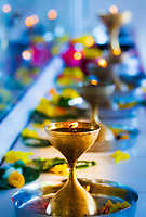 Offerings and golden candles in the Maheswarnath mandir Temple, largest Hindu temple in Mauritius Island, Africa