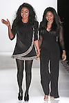 Fashion designer Ese Azenabor (left) walks runway with at the close of her Ese Azenabor Fall Winter 2015 collection, during Fashion Gallery New York Fashion Week Fall 2015.