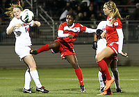 BOYDS, MARYLAND - April 06, 2013:  Jasmyne Spencer (20) of The Washington Spirit sends a header past Kristen McNabb (14) of the University of Virginia women's soccer team in a NWSL (National Women's Soccer League) pre season exhibition game at Maryland Soccerplex in Boyds, Maryland on April 06. Virginia won 6-3.