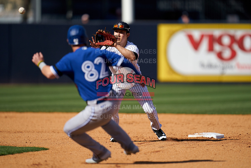 New York Yankees second baseman Hoy Jun Park in a run down with base runner Forrest Wall (82) during a Spring Training game against the Toronto Blue Jays on February 22, 2020 at the George M. Steinbrenner Field in Tampa, Florida.  (Mike Janes/Four Seam Images)