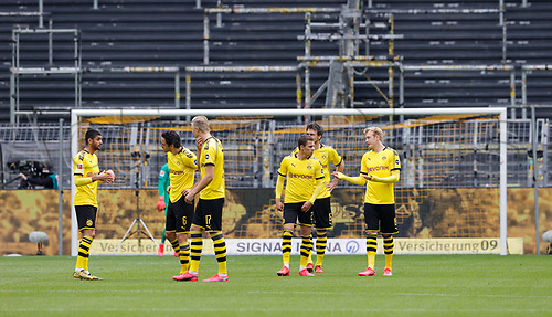 16th May 2020, Signal Iduna Park, Dortmund, Germany; Bundesliga football, Borussia Dortmund versus FC Schalke;  Dortmund players DAHOUD, DELANEY, HAALAND, HAZARD, HUMMELS and BRANDT discuss tactics before kick-off; in the background the empty south stand