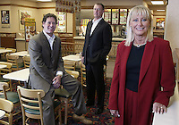 Wendy's chief executive officer Kerrii Anderson, right, chief marketing officer Ian Rowden, center, and chief operating officer Dave Near at a Wendy's restaurant Thursday, May 11, 2006, in Dublin, Ohio.<br />