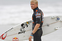 Aussie Mick Fanning ponders over his before he enters the water during round of 48 at the 2010 US Open of Surfing in Huntington Beach, California on August 5, 2010.