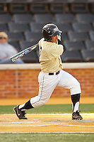 Joey Rodriguez (7) of the Wake Forest Demon Deacons follows through on his swing against the North Carolina State Wolfpack at Wake Forest Baseball Park on March 15, 2013 in Winston-Salem, North Carolina.  The Wolfpack defeated the Demon Deacons 12-6.  (Brian Westerholt/Four Seam Images)