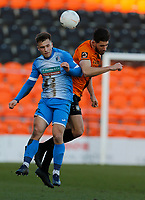 Oliver Dyson (L) of Barrow competes for the ball with Dan Sweeney during Barnet vs Barrow, Buildbase FA Trophy Football at the Hive Stadium on 8th February 2020