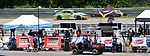 SALISBURY, CT. - 17 July 2021-071721SV07-Cars race past the pits during the IMSA Northeast Grand Prix event at Lime Rock Park in Lakeville Saturday.  <br /> Steven Valenti Republican-American