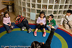 Education preschoool children ages 3-5 circle time one child raising hand the others sleepy bored distracted inattentive horizontal
