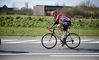 Lars Bak (DEN/Lotto-Soudal) snacking while away with the breakaway group.<br /> Check his on-board camera underneath his saddle...<br /> <br /> 99th Ronde van Vlaanderen 2015