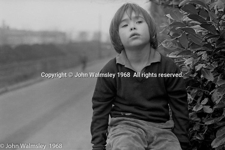 Playing on the school's outside wall, Summerhill school, Leiston, Suffolk, UK. 1968.