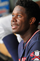 Starting pitcher Touki Toussaint (20) of the Rome Braves talks to teammates between innings of a game against the Greenville Drive on Thursday, September 1, 2016, at Fluor Field at the West End in Greenville, South Carolina. Rome won, 3-2. (Tom Priddy/Four Seam Images)