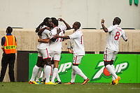 Trinidad and Tobago midfielder Keon Daniel (19) celebrates scoring with teammates during a CONCACAF Gold Cup group B match at Red Bull Arena in Harrison, NJ, on July 8, 2013.