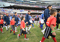 US men's national team with escorts. The USA defeated Honduras, 2-1, in a World Cup qualifying match at Soldier Field in Chicago, IL on June 6, 2009.