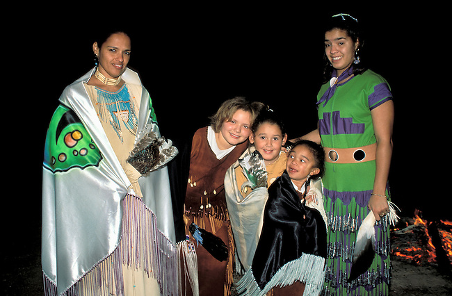 A group of Nanticoke girlsdressed in their fancy shawls and regalia attend a small pow wow dance at the Nanticoke Museum in Millsboro Delaware