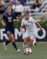 Harvard University midfielder Meg Casscells-Hamby (3) brings the ball forward. In overtime, Harvard University defeated Yale University,1-0, at Soldiers Field Soccer Stadium, on September 29, 2012.