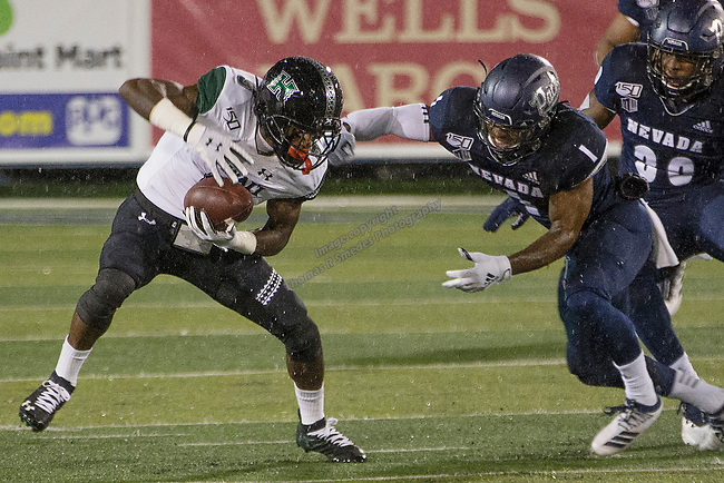 Hawaii receiver JoJo Ward (9) is grabed by Nevada's Berdale Robins (1) in the first half of an NCAA college football game in Reno, Nev. Saturday, Sept. 28, 2019. (AP Photo/Tom R. Smedes)
