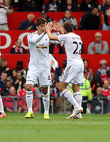 Pictured L-R: Ki Sung Yueng of Swansea celebrating his opening goal with team mate Angel Rangel. Saturday 16 August 2014<br />