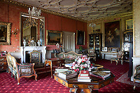 The drawing room, with its crimson damask covered walls