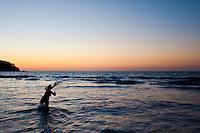 Fisherman casting hand net as the sun sets, Sayulita, Mexico