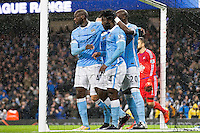 Wilfried Bony celebrates scoring his sides first goal with Yaya Toure and Eliaquim Mangala during the Barclays Premier League Match between Manchester City and Swansea City played at the Etihad Stadium, Manchester on 12th December 2015. 1-0