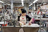 MAY 15, 2014 - KOJIMA, KURASHIKI, JAPAN: workers sew jeans at the Betty Smith's Sewing factory. (Photograph / Ko Sasaki)