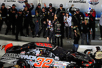 Feb 7, 2009; Daytona Beach, FL, USA; ARCA RE/MAX Series driver James Buescher celebrates after winning the Lucas Oil Slick Mist 200 at Daytona International Speedway. Mandatory Credit: Mark J. Rebilas-