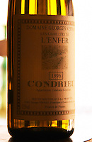 A bottle of Les Chaillee de l'Enfer Condrieu 1996, detail of label. Chaille is a soil type and Enfer refers to the hellish slopes.  Condrieu, Rhone, France, Europe  Domaine Georges Vernay