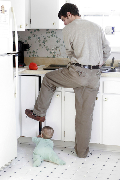 My husband tries to make lunch and keep the cupboard door shut from our seven month old son's prying hands.