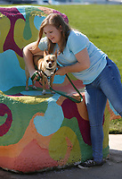 Hazelynn Shettles reaches in to pick up Sam Thursday, June 3, 2021, after attempting to take a photograph of the chihuahua on a sculpture in front of the Jones Center in Springdale. Shettles was with a friend and another dog exploring the grounds of the center. Check out nwaonline.com/210604Daily/ and nwadg.com/photos for a photo gallery.<br /> (NWA Democrat-Gazette/David Gottschalk)