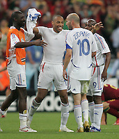 French forward (12) Thierry Henry embraces team captain (10) Zinedine Zidane after the game.  France defeated Portugal, 1-0, in their FIFA World Cup semifinal match at FIFA World Cup Stadium in Munich, Germany, July 5, 2006.