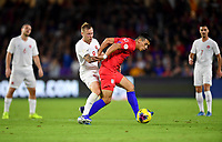 ORLANDO, FL - NOVEMBER 15: Alfredo Morales #15 of the United States moves with the ball past Scott Arfield #8 of Canada during a game between Canada and USMNT at Exploria Stadium on November 15, 2019 in Orlando, Florida.