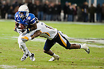 Air Force running back Asher Clark bobbles a pitch during the first half in then Military Bowl at Robert F. Kennedy Stadium in Washington, D.C. on December 28, 2011.