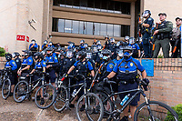 AUSTIN, TEXAS - MAY 30, Austin Police officers form a barricade using bicycles to protect themselves from a rally protesting the killing of George Floyd and Mike Ramos at APD Headquarters on May 30, 2020 in Austin, Texas.<br />