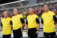 Sir Alex Ferguson (2 from R) of Manchester United and members of his coaching staff. Manchester United (EPL) defeated the Philadelphia Union (MLS) 1-0 during an international friendly at Lincoln Financial Field in Philadelphia, PA, on July 21, 2010.