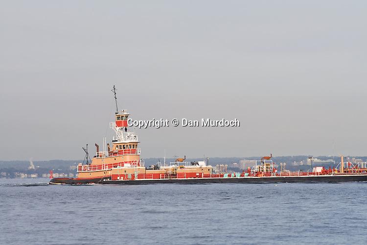 Tug boat pusing barge