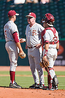 Florida State Seminoles head coach Mike Martin #11 has a chat with Sean Gilmartin #3 and Rafael Lopez #29 at the 2010 ACC Baseball Tournament at NewBridge Bank Park May 26, 2010, in Greensboro, North Carolina.  The Hurricanes defeated the Seminoles 9-3.  Photo by Brian Westerholt / Four Seam Images