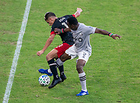 WASHINGTON, DC - NOVEMBER 8: Yamil Asad #11 of D.C. United fights for the ball with Victor Wanyama #2 of the Montreal Impact during a game between Montreal Impact and D.C. United at Audi Field on November 8, 2020 in Washington, DC.